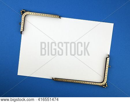 Two Angle Metal Purse Frames And White Blank Paper For Text. Concept Of Purses Or Bags Making
