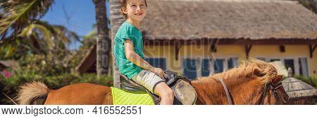 Smiling, Young Boy Ride A Pony Horse. Horseback Riding In A Tropical Garden Banner, Long Format