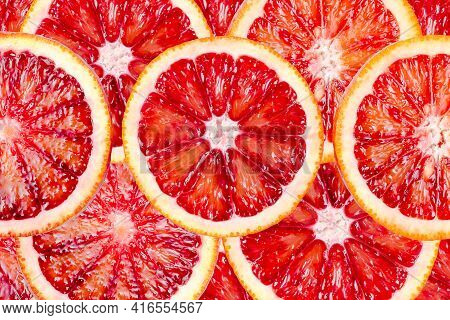 Sliced Bloody Oranges Texture. Fresh Ripe Red Sicilian Orange, Citrus Fruit For Background