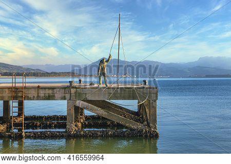03-27-2019 Santoña, Cantabria, Spain. Bronze Sculpture That Reproduces A Sulas Fisherman (small Silv