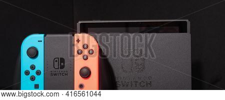 Nintendo Switch video game console developed by Nintendo, released on March 3, 2017 on a black background. Germany, Berlin - June 30, 2019: Nintendo Switch Joy-con controller on a Black background