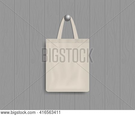 White Tote On Wood Wall. Mockup Of Eco Canvas Bag With Handle. Cotton Fabric Tote. Reusable Cloth Of