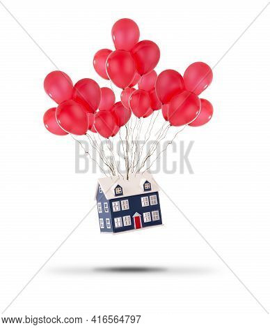Toy House Lifted Up With Red Balloons Isolated On A White Background. House Prices Rising And Moving
