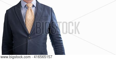 Close-up Of Torso Man In Suit And Tie. Torso Of A Businessman In A Suit. Cropped Portrait Of A Succe