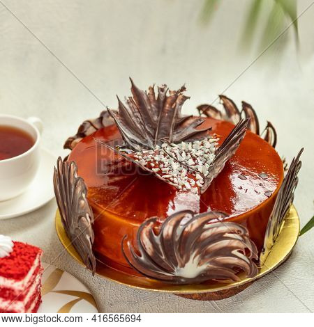 Red Brulee Cake With Cup Of Tea
