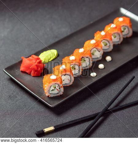 California Unagi Sushi Roll With Wasabi, Ginger And Black Chopstick