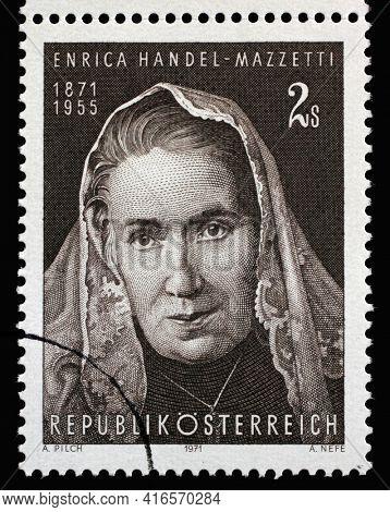 ZAGREB, CROATIA - SEPTEMBER 09, 2014: Stamp printed in Austria shows Enrica von Handel-Mazzetti(1871-1955), Austrian poet and writer, known for writing historical romances, circa 1971.