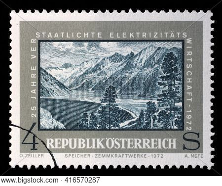 ZAGREB, CROATIA - SEPTEMBER 09, 2014: A stamp issued in the Austria shows Water Reservoir Zemm, the 25th Anniversary of Nationalized Electricity, circa 1972