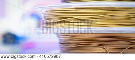 Spools of metallic PLA plastic filaments for 3D Printer