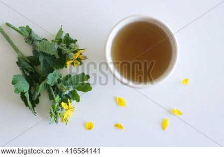 Natural Home Skin Care.celandine Juice And Green Tea Infusion On A White Background. Free Space.