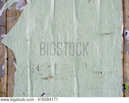Creased Crumpled Placard With Empty Space On The Wall. Grunge Background.