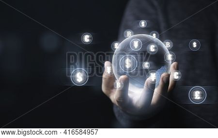 Global Currency Exchange Concept, Businessman Holding World With Virtual Global Currency Such As  Do