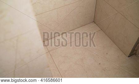 Tile Series:tile Border Being Installed On Shower Wall In Home. Ceramic Floor Tile Application. Bath