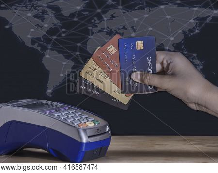 Young Business Showing All Credit Cards On Mobile Card Reader And Hand Entering Security Pin In Cred