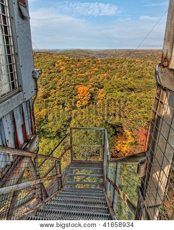 Metal Staircase Above Autumn View Of Forest