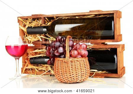 Wooden case with wine bottle, wineglass and grape isolated on white