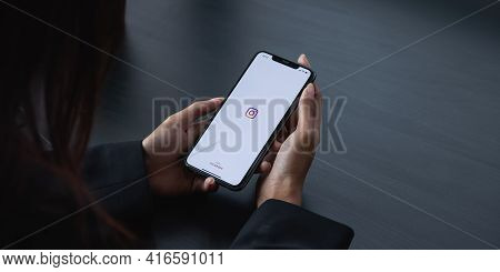 Chiang Mai, Thailand - Apr 6 2021: Woman Hand Holding Iphone With Logo Of Instagram Application. Ins