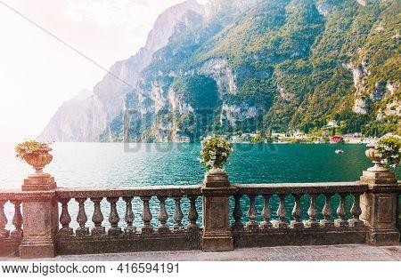 View Of The Beautiful Italian Garda Lake Surrounded By Mountains. Riva Del Garda City, Trentino Alto