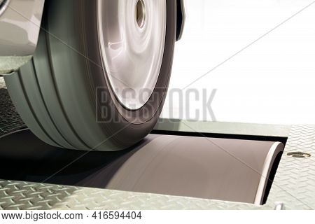 Close Up Of Vehicle Tire And Rim Rotation With Blurry Motion On Roller Chassis Dynamo