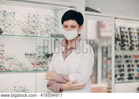 Portrait Of An Optometrist Ophthalmologist Middle Aged Woman Wearing Protective Medical Face Mask