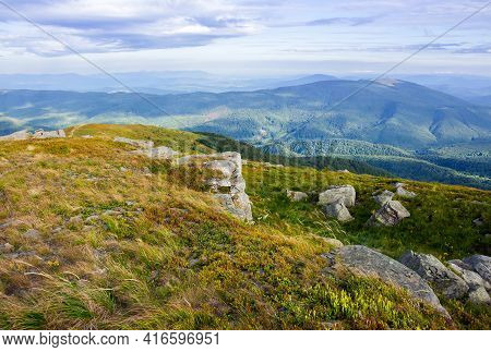 Landscape Of Carpathian Mountains. Stones On The Hill. View In To The Distant Valley. Clouds On The