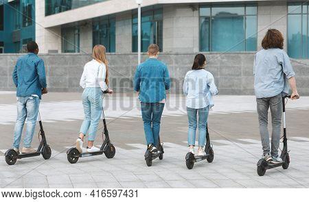Five Students Having Ride On Motorized Kick E-scooters