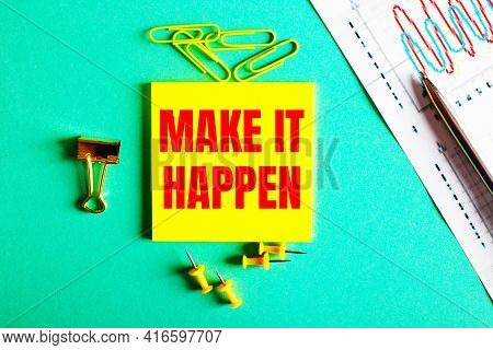 Make It Happen Is Written In Red On A Yellow Sticker On A Green Background Near The Graph And Pencil