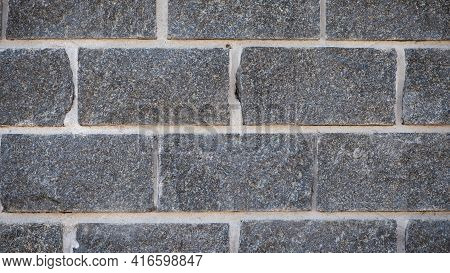 Wall Of Stones. Brick Wall. Gray Background With Black Geometric Patterns, Of Rectangular Stones, Br