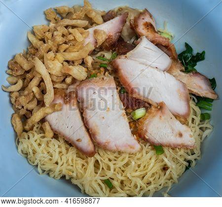 Close-up Of Egg Noodle With Sliced Red Roasted Pork And Wonton, Streaky Pork With Crispy Crackling I