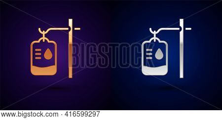 Gold And Silver Iv Bag Icon Isolated On Black Background. Blood Bag. Donate Blood Concept. The Conce