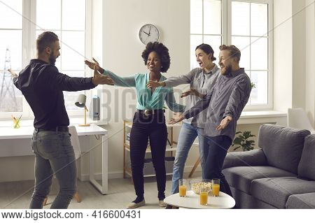 Group Of Young People Are Excited To See Their Friend Whos Been Away For A Long Time