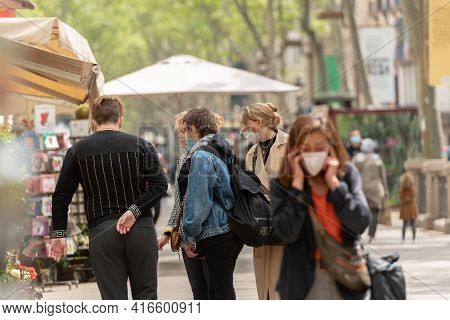 Barcelona, Catalonia: 2021 April 6: People Walk In The Ramblas In The City Of Barcelona In Time Of C