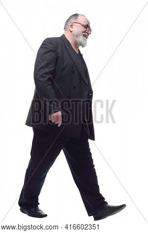 satisfied man in a business suit striding forward .