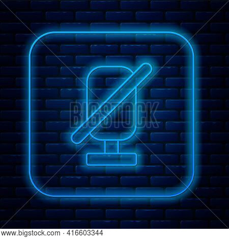 Glowing Neon Line Mute Microphone Icon Isolated On Brick Wall Background. Microphone Audio Muted. Ve
