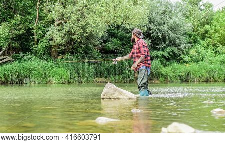 The Addiction Is Real. Sport Activity Hobby. Experienced Fisher In Water. Successful Fly Fishing. Su