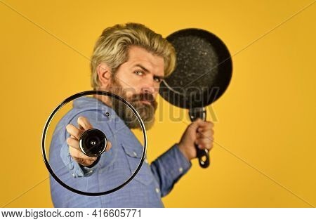 Vegetarian Concept. Healthy Food Cooking. Cooking Tasty Dish. Bearded Man Hold Frying Pan. Cooking I