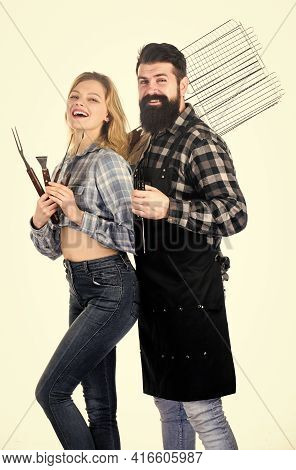 Roasting And Grilling Food. Cooking Together. Couple In Love Hold Cooking Utensils Barbecue. Tools F