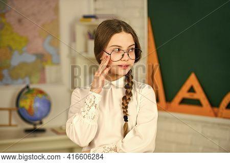 Adorable School Nerd. Introducing New Units Of Work. Kid Girl Wear Eyeglasses. Back To School Concep