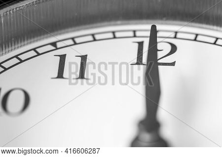Clock Hand Pointing Twelve O'clock On White Clock Face Of Twin Bell Classic Alarm Clock