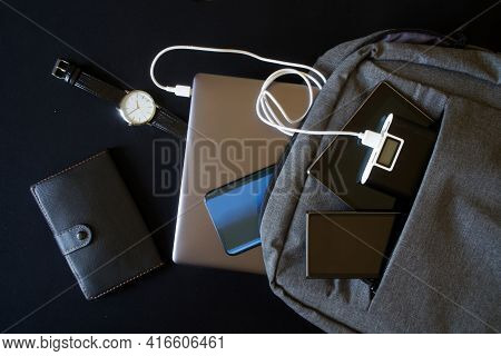 An External Battery - Power Bank And Many Modern Gadgets: Smartphones, Laptop And Tablet Are In A Tr