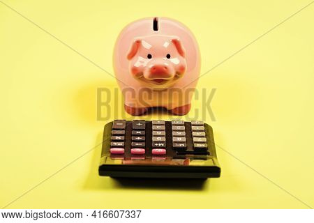 Moneybox With Calculator. Piggy Bank. Planning And Counting Budget. Money Saving. Accounting And Pay