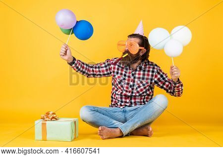 Happy Birthday To You. Bearded Mature Man Celebrate Birthday Party. Cheerful Man In Bday Hat Hold Ho