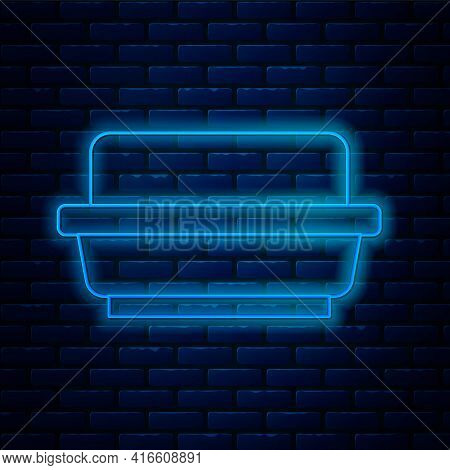 Glowing Neon Line Butter In A Butter Dish Icon Isolated On Brick Wall Background. Butter Brick On Pl