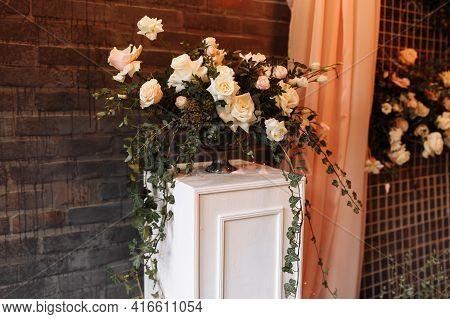 Wedding Decor. Photographic Area Is A Stylish Wedding Decoration. Decorated With Flowers, Mini Flora