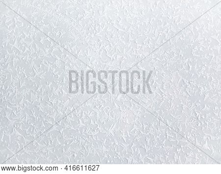 A Surface Covered With An Icy Snowy Pattern. White Snowy Background. Natural Snowy Frosty Patterns.