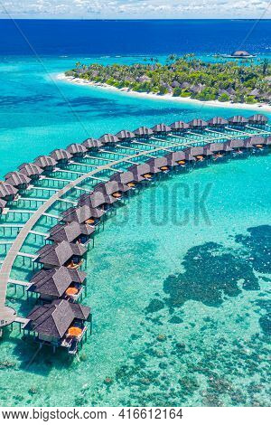 The Drone Photo With A Wooden Water Villas Seen From Above And An Amazing Blue Lagoon Crystal Clear