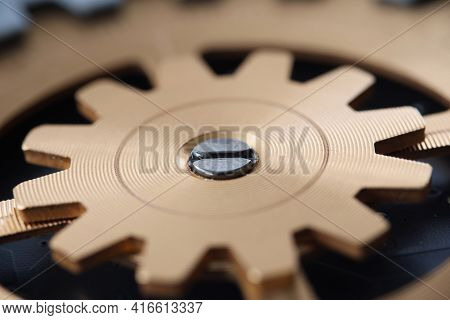 Closeup Of Gold Spare Part Of Gear In Clockwork