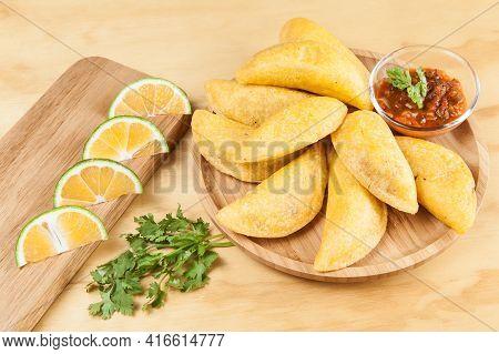 Tasty Colombian Food, Fried Empanada; Photo On Wooden Background.