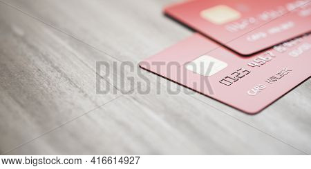 Online Banking Concept With Red Credit Cards On Light Wooden Backdrop With Copyspace, 3d Rendering,