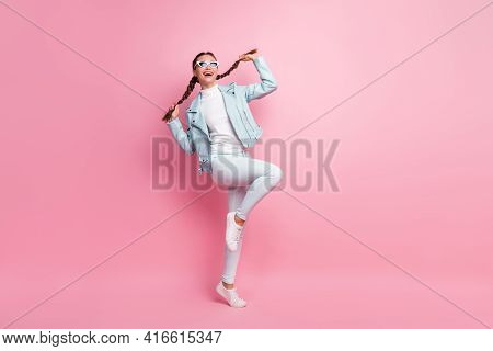 Full Length Photo Of Young Excited Girl Cheerful Playful Look Empty Space Isolated Over Pink Color B